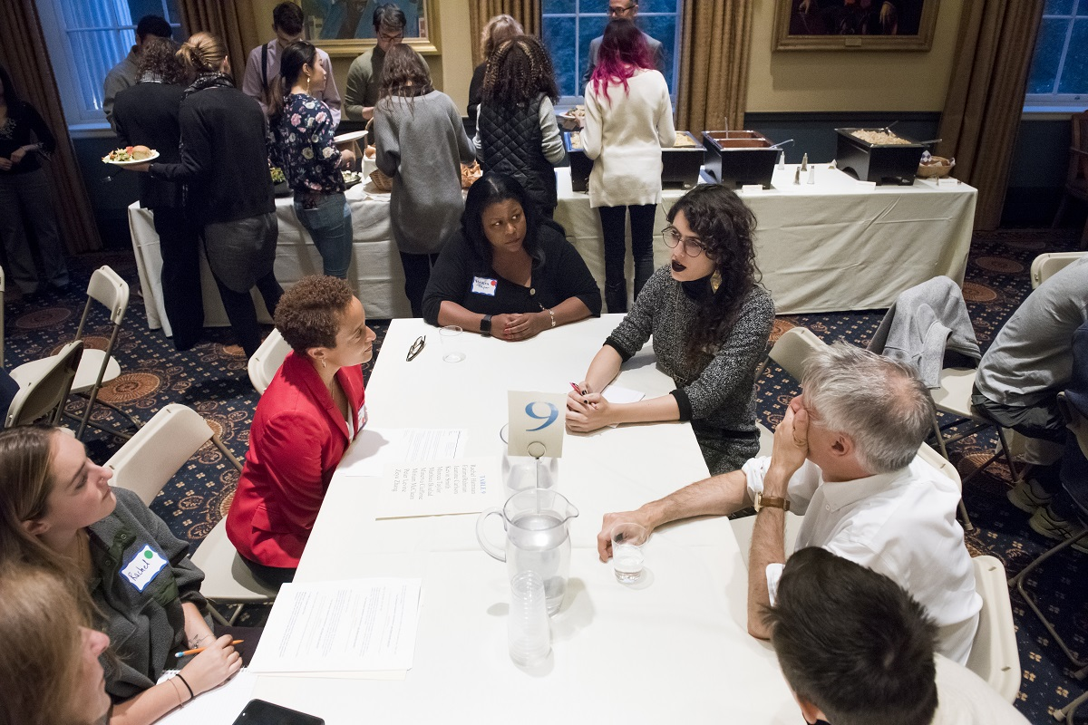 Tufts students, faculty, and staff gather to discuss topics at the first Tufts Table.