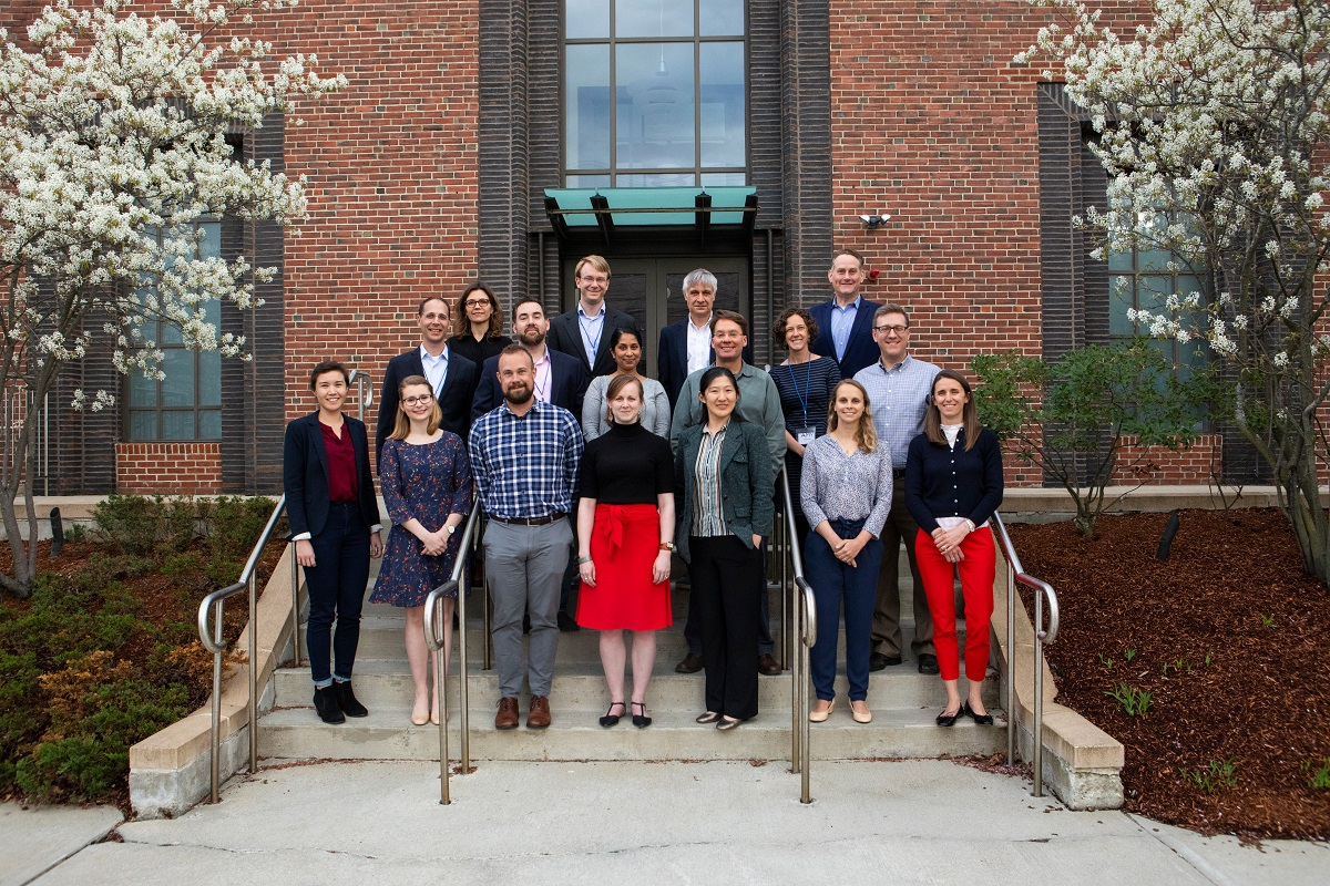 Faculty mentors from cohort two pose on steps outside of a brick building.